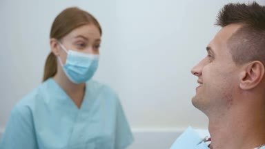 dentist explaining to the patient