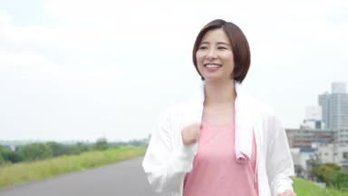 woman walking with a smile