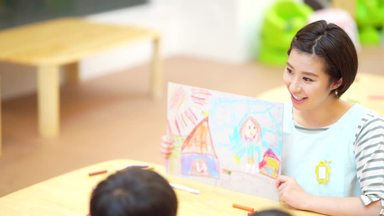 nursery teacher laughing at the story