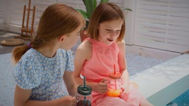 girl playing with only her feet in the pool