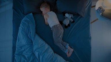 son sleeping in the bedroom